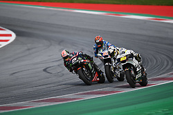 August 12, 2018 - Spielberg, Austria - 5 French driver Johann Zarco of Team Monster Yamaha Tech 3 overtake on last corner of last lap  53Spanish driver Tito Rabat of Team Reale Avintia Racing and  19 Spanish driver Alvaro Bautista of Team Aspar MotoGP Team during of Austrian MotoGP grand prix in Red Bull Ring in Spielberg, Austria, on August 12, 2018. (Credit Image: © Andrea Diodato/NurPhoto via ZUMA Press)