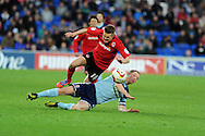 Boro's Grant Leadbitter tackles Cardiff's Craig Noone. NPower Championship, Cardiff city v Middlesbrough at the Cardiff city stadium in Cardiff in South Wales on Saturday 17th November 2012.  pic by Andrew Orchard, Andrew Orchard sports photography,