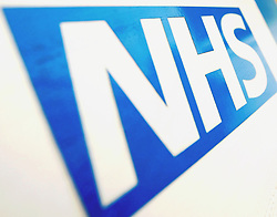 File photo dated 07/12/10 of the NHS logo. Thousands of NHS staff are to be trained to use robotics and artificial intelligence as the health service sets out to embrace cutting-edge innovation and technology.