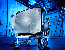 Steampunk Television picture tube on wheels with ghost entity coming out of picture tube