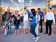 14 OCTOBER 2011 - SCOTTSDALE, AZ:   Apple Store employees run around the Apple Store and greet shoppers at the Scottsdale Quarter just before opening the store and starting sales of the iPhone 4S. Hundreds of people lined up at the Apple Store in the Scottsdale Quarter in Scottsdale, AZ, Friday, Oct. 14, to buy the iPhone 4S. The phone sold out in pre-orders last week and sales at the Scottsdale Apple Store were brisk through the morning.   PHOTO BY JACK KURTZ