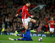Zlatan Ibrahimovic of Manchester United jumps over Mason Holgate of Everton  during the English Premier League match at Old Trafford Stadium, Manchester. Picture date: April 4th 2017. Pic credit should read: Simon Bellis/Sportimage