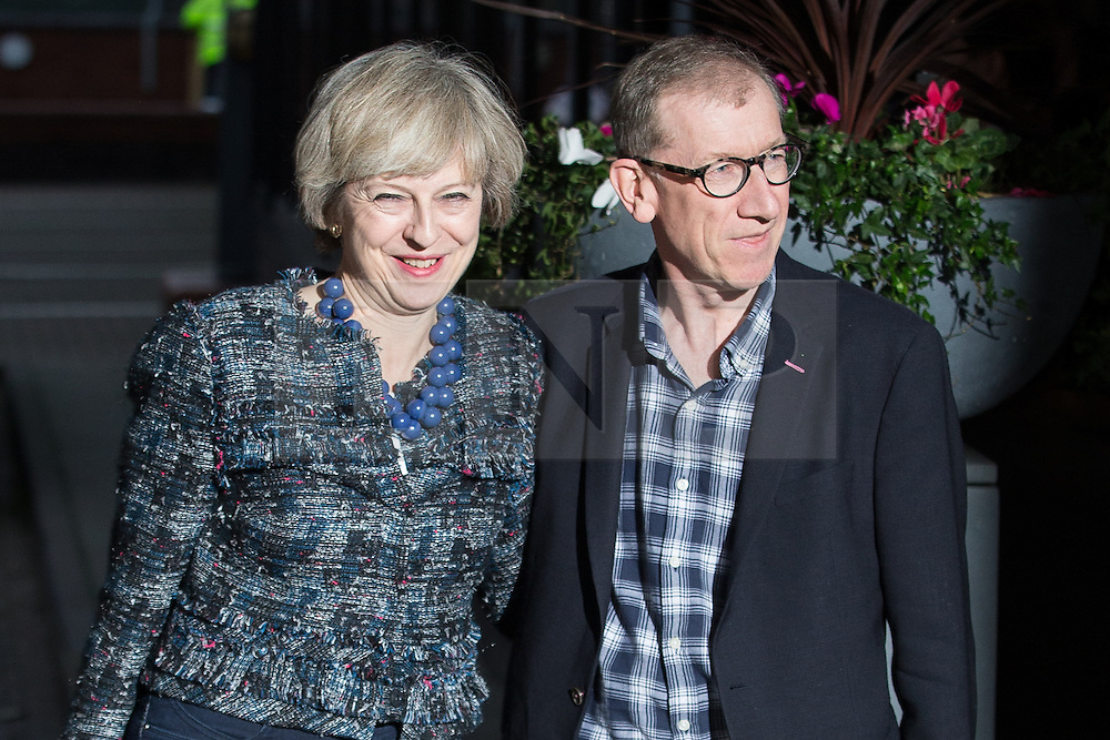 © Licensed to London News Pictures . 01/10/2016 . Birmingham , UK . British Prime Minister and Conservative Party leader THERESA MAY and her husband PHILIP MAY arrive at the Hyatt Regency hotel ahead of the start of the Conservative Party conference at the ICC in Birmingham . Photo credit : Joel Goodman/LNP