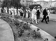 An Taoiseach, Dr Garret FitzGerald TD, leads a parade of contestants for the Rose of Tralee Festival to a reception at Government Buildings, Leinster House, Dublin, including Marian Ryan (Waterford) and Catherine O'Connor (Dublin).<br /> 28 August 1981