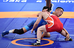 JAKARTA, Aug. 19, 2018  Bekhbayar Erdenebat (L) of Mongolia vies with Kang Kum Song of the Democratic People's Republic of Korea during Men's Wrestling Freestyle 57 kg Final of the 18th Asian Games in Jakarta, Indonesia, Aug. 19, 2018. Erdenebat won 8-2. (Credit Image: © Yue Yuewei/Xinhua via ZUMA Wire)