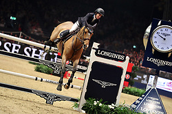 USA's Laura Kraut riding Viper Vrombautshoeve Z competes in the Martin Collins enterprises Christmas Tree stakes during day five of the London International Horse Show at London Olympia.