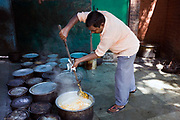 Head chef Mohammed Azad cooks biryani at Babu Shahi Bawarchi, New Delhi, India<br /> The famous but modest takeaway housed in the grounds of a shrine is famous for its biryani and whose owners ancestors served as chief cooks under the Moghul Emperor, Shah Jahan
