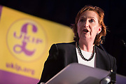 Suzanne Evans, UKIP's Community spokesman and Merton Councillor, addresses UKIP meeting. The UK Indepenence Party, campaigns as an anti racist party whilst against immigration and the EU. The front rows of the hall are filled with multi ethnic supporters to reinforce the message.