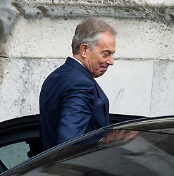 © Licensed to London News Pictures. 11/12/2015. London, UK. Former British prime minister TONY BLAIR grinning as he leaves the House Of Parliament in London after being questioned by MPs on the Foreign Affairs Committee on the UK's foreign policy towards Libya during his time in Government. Photo credit: Ben Cawthra/LNP