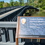 Sign and bridge at the Lyndon Baines Johnson Memorial Grove. The memorial is set in Lady Bird Johnson Park on the banks of the Potomac on the George Washington Memorial Parkway in Arlington, Virginia.