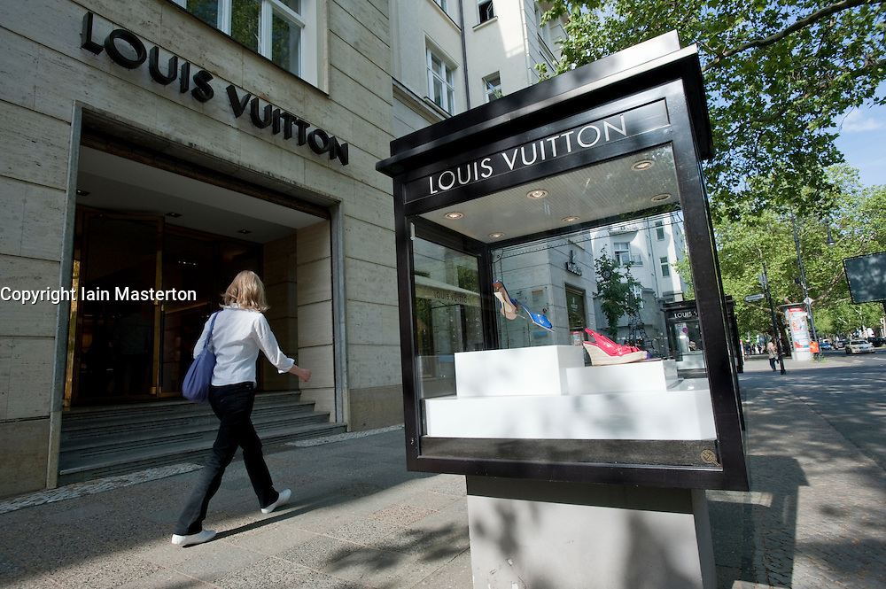 Luxury products on display in glass cabinets outside Louis Vuitton store on Kurfurstendamm in Charlottenburg Berlin Germany