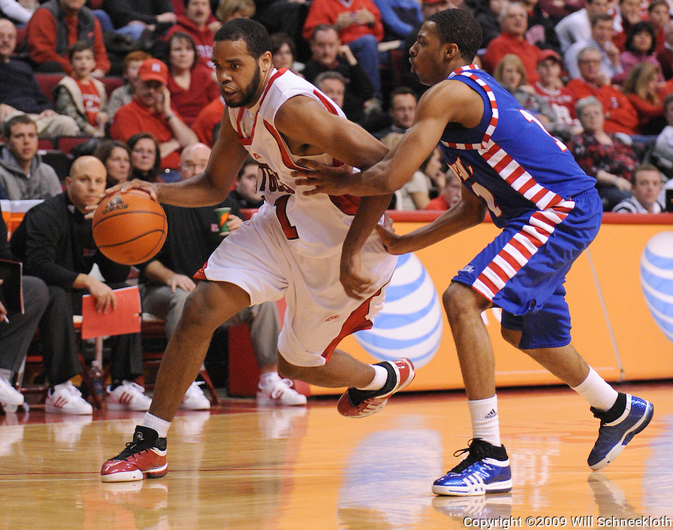 Jan 31, 2009; Piscataway, NJ, USA; Rutgers guard Earl Pettis (L) drives to the net against DePaul guard Jeremiah Kelly (R) during the second half of  Rutgers' 75-56 victory over DePaul in NCAA college basketball at the Louis Brown Athletic Center