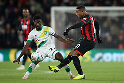 Norwich City's Alexander Tettey and Bournemouth's Jordon Ibe (right) battle for the ball during the Carabao Cup, Fourth Round match at the Vitality Stadium, Bournemouth.