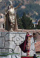 """Inti Raymi. The actor Nivardo Carrillo, for many years played """"El Inca"""" (Pachacutec)n, the central figure of Inti Raymi, here in the square next to the monument to Inca Manco Qapach few years reinstalled on the central fountain of the Plaza Mayor. The Inca is thanking the spirits of the mountains (apus) and the sun god (Inti)  for the great success of the event"""