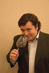Chile Wine Country: Hector Riquelme, sommelier for World of Wine in Santiago, tasting wine..Photo #: ch402-32798.Photo copyright Lee Foster, 510-549-2202, www.fostertravel.com, lee@fostertravel.com.