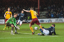 Motherwell's keeper Dan Twardzik heads towards Dundee's Luka Tankulic and Motherwell's Mark O'Brien on way the the ball ends up in the net for Dundee's fourth goal. <br /> Dundee 4 v 1 Motherwell, SPFL Premiership played 10/1/2015 at Dundee's home ground Dens Park.