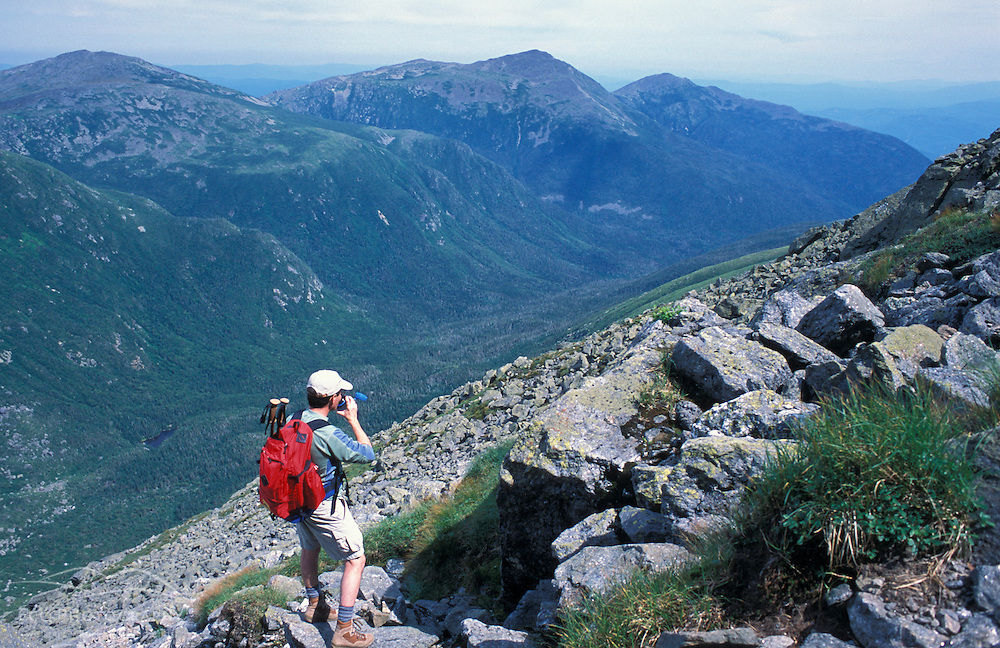 Mt. Washington, NH.A hiker takes photos on the Great Gulf headwall.  Great Gulf Trail.  Wilderness Area.  Northern Presidentials.  White Mountains National Forest.