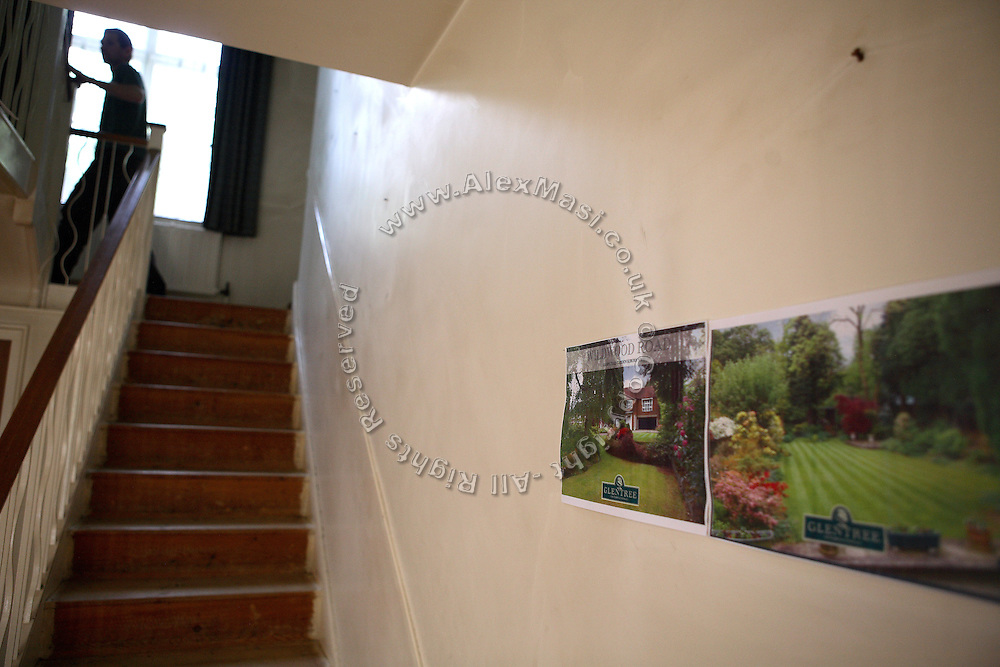 Zil, 23, from Poland, is running up the stairs leading to his room in the Wildwood Road mansion on Sunday, July 1, 2007, in Hampstead, London, England. Old posters from GlenTree, a property agent, are affixed on the wall picturing the mansion in its best conditions and ready to be sold. Situated opposite Hampstead Heath, North London's green jewel the average price for properties on this road reaches £ 2,500,000. Million Dollar Squatters is a documentary project in the lives of a peculiar group of squatters residing in three multi-million mansions in one of the classiest residential neighbourhoods of London, Hampstead Garden. The squatters' enthusiasm, their constant efforts to look after what has become their home, their ingenuity and adventurous spirit have all inspired me throughout the days and nights spent at their side. Between the fantasy world of exclusive Britain and the reality of squatting in London, I have been a witness to their unique story. While more than 100.000 properties in London still lay empty to this day, squatting provides a valid, and lawful alternative to paying Europe's most expensive rent prices, as well as offering the challenge of an adventurous lifestyle in the capital.