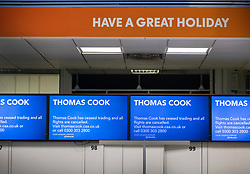 © Licensed to London News Pictures. 23/09/2019. Gatwick, UK. A sign says 'HAVE A GREAT HOLIDAY' above closed Thomas Cook check-in desks at Gatwick Airport after the travel firm collapsed. The 178 year old travel operator has gone in to liquidation after rescue talks failed overnight. This will trigger the largest peacetime repatriation as more than 150,000 British holidaymakers will need to be brought home. Photo credit: Peter Macdiarmid/LNP