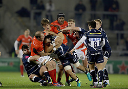Sale Sharks TJ Ioane is held up by the Saracens defence during the European Champions Cup, pool three mach at the AJ Bell Stadium, Salford.