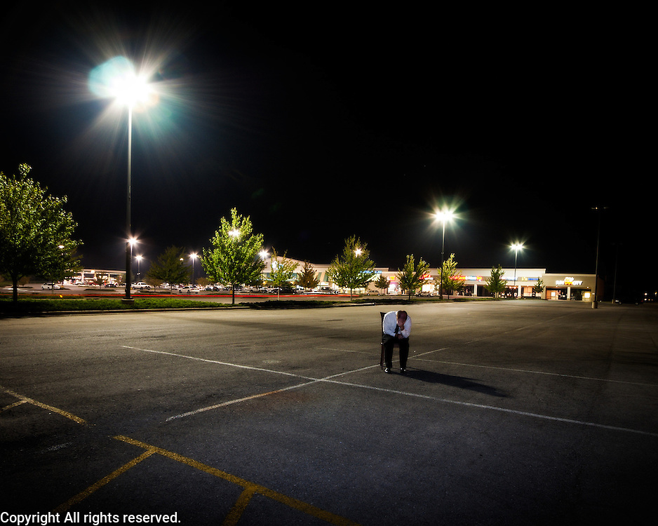 This photo is the second in the series.  The first obviously showed a physical isolation and my thought was that by shooting this one at night in an empty parking lot I could achieve the same concept in a suburban location.  I think each image has their merits.