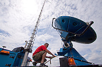 Doppler on Wheels truck number 7 driver Herb Stein climbs atop the truck to tie down the radar dish in the sandhills of north-central Nebraska, May 29 2010.  DOW 7 is participating in Project Vortex 2, a two year science mission to study tornadoes.