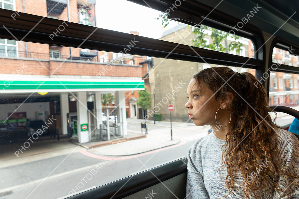 Young girl travels by bus in London