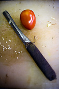 Detail of a knife and a tomato at Karim's Restaurant, Delhi, India