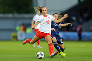 Lia Walti (#13) of Switzerland and Christie Murray (#16) of Scotland battle for possession of the ball during the 2019 FIFA Women's World Cup UEFA Qualifier match between Scotland Women and Switzerland at the Simple Digital Arena, St Mirren, Scotland on 30 August 2018.