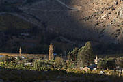View of church and village in valley between mountains, Elqui Valley, Chile