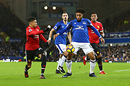 Ashley Williams of Everton shields the ball from Jesse Lingard of Manchester United. Premier league match, Everton v Manchester Utd at Goodison Park in Liverpool, Merseyside on New Years Day, Monday 1st January 2018.<br /> pic by Chris Stading, Andrew Orchard sports photography.