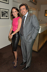 RAMAN & LAURENCE (her) BET-MANSOUR at a film screening in aid of the charity Women for Women held at BAFTA, 195 Piccadilly, London on 26th February 2014.