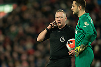Football - 2019 / 2020 Premier League - Liverpool vs. West Ham United<br /> <br /> Jonathan Moss checks VAR decision , at Anfield.<br /> <br /> COLORSPORT/TERRY DONNELLY