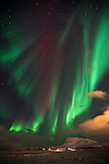 Northern lights over a farm in Mosfellsdalur, southwest Iceland
