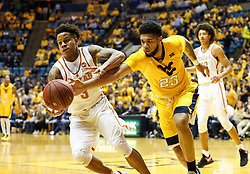 Jan 20, 2018; Morgantown, WV, USA; Texas Longhorns guard Jacob Young (3) and West Virginia Mountaineers forward Esa Ahmad (23) go for a loose ball during the second half at WVU Coliseum. Mandatory Credit: Ben Queen-USA TODAY Sports