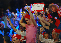 Fans celebrate Canada's John Part beating Wales's Richie Burnett 4-1 to move to the next round in the Darts World Championships at Alexandra Palace, London, Tuesday, Dec.. 27, 2011. photo by morn/I-Images