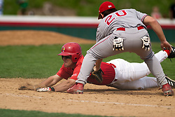 15 April 2006:  Braves 1st Baseman, Jason Newburger catches Redbird runner Matt Bolt a foot shot of the bag on a throw to first by the Bradley pitcher. Bradley University Braves are defeated in game one of a double header against the Illinois State University Redbird at Redbird Field in Normal IL.