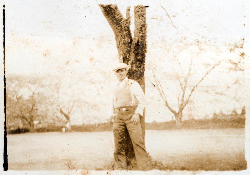 man standing by a tree Jpan ca 1930s