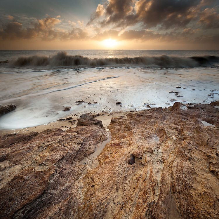 Sunrise at Benacre and Covehithe. This is a two shot vertorama to get the most out of the foreground rocks. Don't usually alter the settings for these but I used a shutter speed of 13 secs on the foreground and 1/10th on the background to avoid too much movement in the waves and sky.