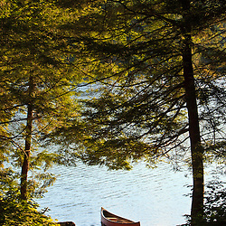 Canoe on the shore next to Zack Woods Pond in Hyde Park, Vermont. Green River Reservoir State Park