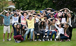 "© Licensed to London News Pictures.22/08/2013. Solihull, West Midlands, UK. Solihull School achieved outstanding GSCE Level Results this year, up on previous years, with 77% of pupils gaining A grade or A Stars. Pictured,pupils celebrating their excellent results with a celebration ""Mobot"". Photo credit : Dave Warren/LNP"