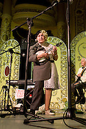 Frances Terry from London, a member of the George Formby Appreciation Society at their annual gathering in Blackpool playing her ukulele to the audience at the town's Winter Gardens. The society was formed in 1961 and holds an annual event to celebrate the life of the famous Lancastrian singer and entertainer.