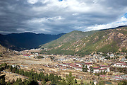 "View of Tashichho dzong in Bhutan's capital city Thimphu. Taschichho Dzong, meaning the fortress of ""auspicious doctrine"" thas traditionally been the seat of the Dharma Raja and summer capital of the country. Presently it houses the throne room and offices of the king, the secretariat and the ministries of home affairs and finance. The Dzong was the site of the formal coronation of the fifth king in 2008 and hosts the city's annual Tsechu festival. The main structure of the dzong is two-storied with four three-storied towers at each corner, topped by triple-tiered golden roofs. In the center of the building is a large central tower called utse."