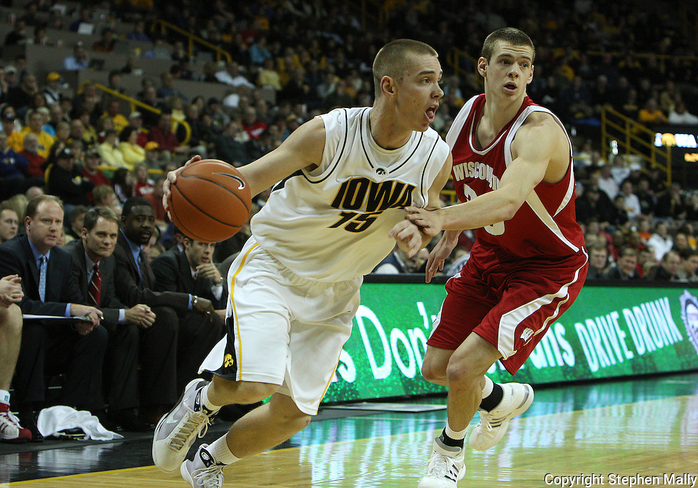 21 JANUARY 2009: Iowa's Devan Bawinkel (15) drives past Wisconsin's Jon Leuer (30) during the first half of an NCAA college basketball game Wednesday, Jan. 21, 2009, at Carver-Hawkeye Arena in Iowa City, Iowa. Iowa defeated Wisconsin 73-69 in overtime.