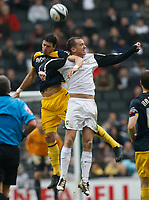 Photo: Steve Bond/Richard Lane Photography. MK Dons v Southampton. Coca-Cola Football League One. 20/03/2010. Jose Fonte (L) leads with his elbow and is booked for the foul on Aaron Wilbraham