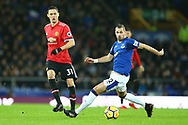 Nemanja Matic of Manchester United (l) passes the ball past Morgan Schneiderlin of Everton. Premier league match, Everton v Manchester Utd at Goodison Park in Liverpool, Merseyside on New Years Day, Monday 1st January 2018.<br /> pic by Chris Stading, Andrew Orchard sports photography.