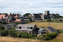 St Aidan's Church and the surrounding village, Bamburgh, Northumberland, England, UK<br /> Photo: Ed Maynard<br /> 07976 239803<br /> www.edmaynard.com