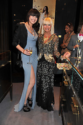 Left to right, DAISY LOWE and VIRGINIA BATES at a private view of jewellery and photographs by Rosie Emerson and Annoushka Ducas entitled Alchemy in association with Ruinart Champagne held at Annoushka, 41 Cadogan gardens, London SW3 on 15th September 2011.