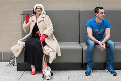 © Licensed to London News Pictures. 26/10/2018. LONDON, UK. A woman dressed as Cruella de Vil (L), from Disney's 101 Dalmations, joins cosplayers from all over the world on the opening day of the bi-annual MCM Comic Con event at the Excel Centre in Docklands.  The event celebrates popular culture such as video, games, manga and anime providing many attendees with the opportunity to dress up as their favourite characters.  Photo credit: Stephen Chung/LNP