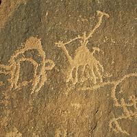 Nabataean petroglyphs decorate a sandstone cliff in the Wadi Rum, Jordan.